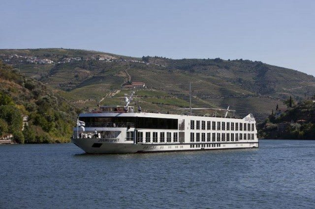 Uniworld's Douro Spirit sailing along the magnificent Douro River Valley. Photo courtesy of Uniworld Boutique River Cruises