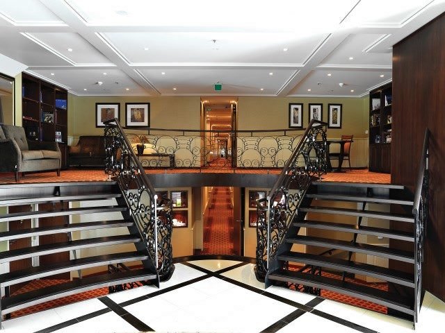 The attractive Reception Lobby aboard AmaDagio contains the ship's forward staircase. Photo courtesy of AmaWaterways.