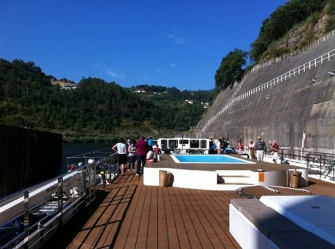 Douro Spirit emerging into the sunlight after transiting a lock. Note the swimming pool - a great place to cool down! Photo © 2012 Peter Saunders