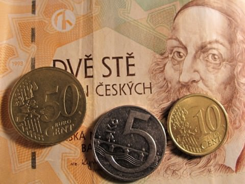 Euro and Czech currency mixed together. Which one should you take with you on your river cruise? And do you pay in cash or with credit? Read on. Photo © 2012 Aaron Saunders