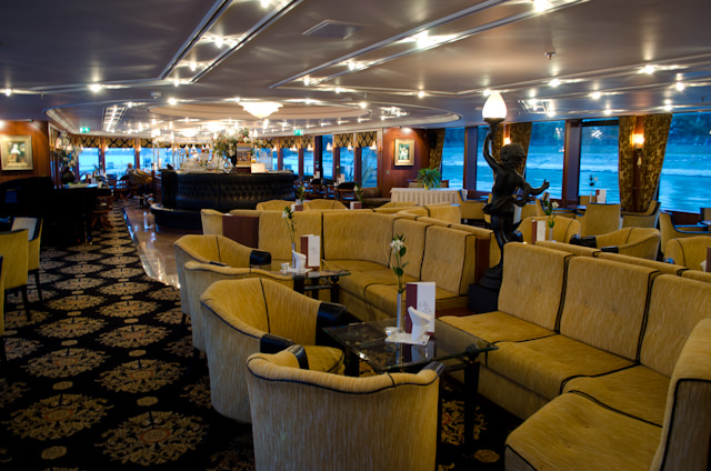 "The Main Lounge aboard Tauck's Swiss Jewel river cruise ship is an elegant throwback to the ""Golden Age"" of European travel. Photo © 2012 Aaron Saunders"