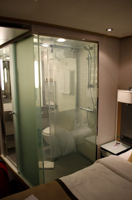 "The bathroom in ""transparent"" mode, as seen from the bedroom of my Category ""A"" stateroom. Photo © 2012 Aaron Saunders"