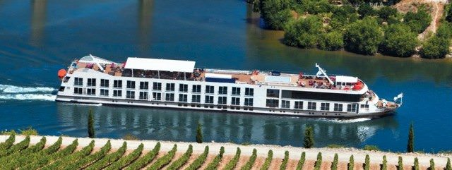 Uniworld's Douro Spirit sails through Portugal's breathtaking Douro River Valley in 2012. This year, a brand-new ship takes over the reigns. Photo courtesy of Uniworld.