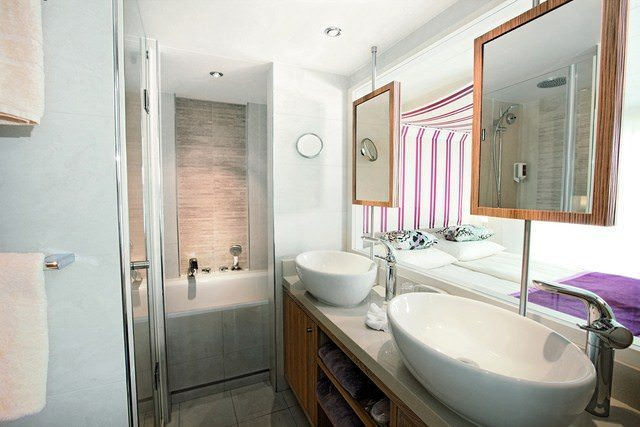 A-ROSA SILVA features two separate suite categories that include amenities like a spacious, dual-vanity bathroom. Photo courtesy of A-ROSA.