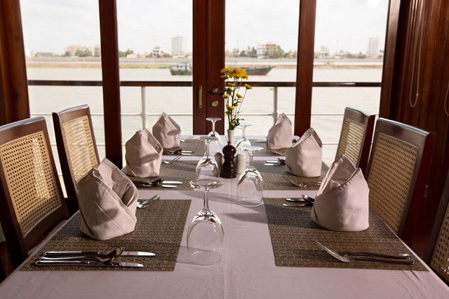 Dining aboard the Angkor Pandaw is, like all Pandaw ships, relaxed and comfortable. Photo courtesy of Pandaw.
