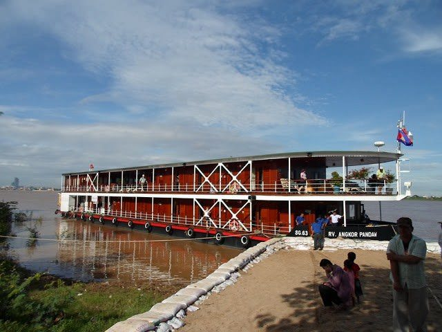 Watching the Angkor Pandaw come alongside on her journey down the Mekong. Photo courtesy of Pandaw.
