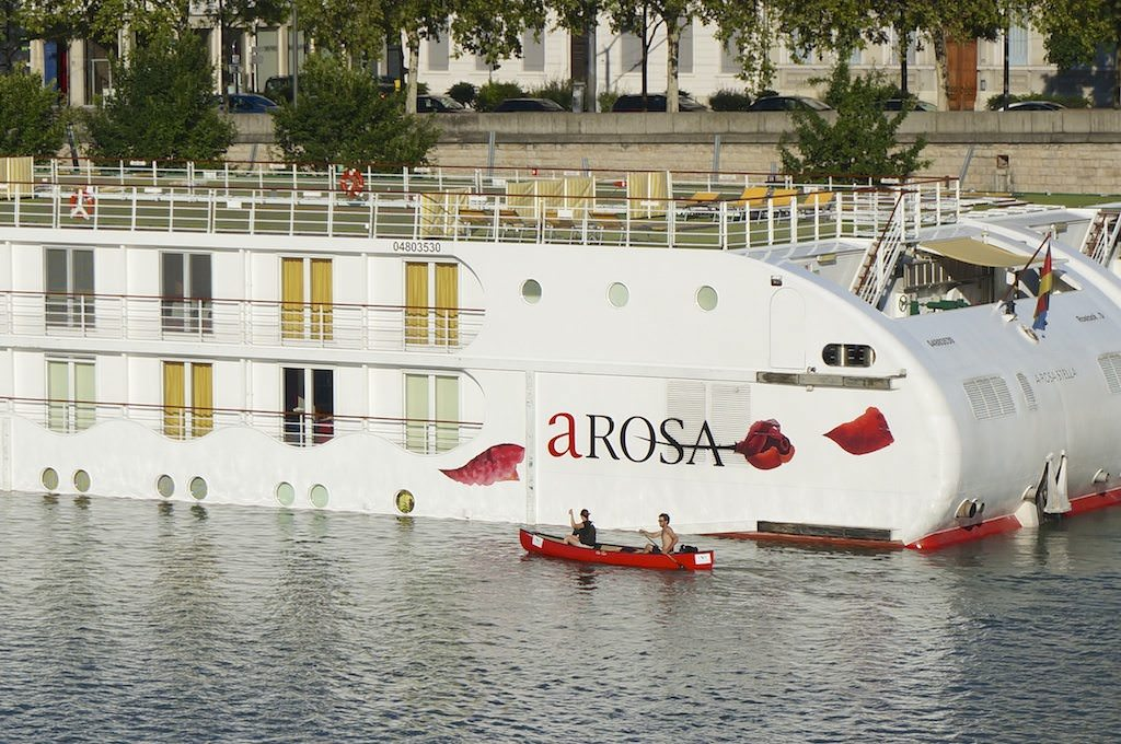 A Canoe Passes A-ROSA Stella In Lyon, France