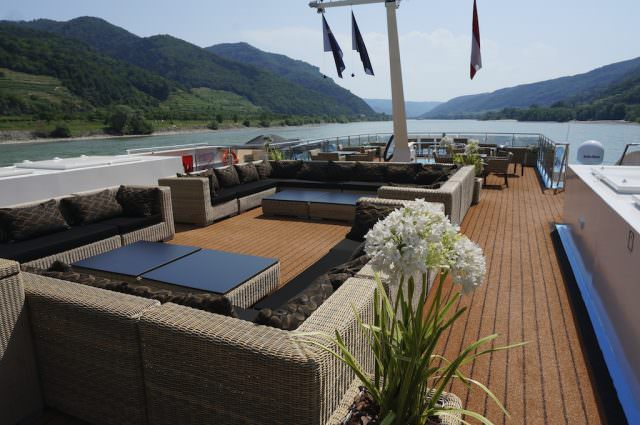 In front of the pilot house, AmaPrima's Sundeck features cozy couches for stretching out as we transit the Danube. @ 2013 Ralph Grizzle
