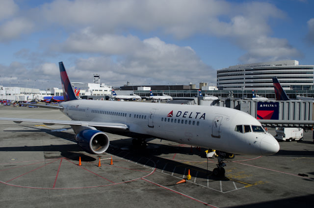 First leg of the trip: Vancouver to Seattle's Tacoma International Airport, pictured above. Delta was having a particularly bad day with Super Typhoon Usagi axing flights to Hong Kong and one to Tokyo. Photo © 2013 Aaron Saunders