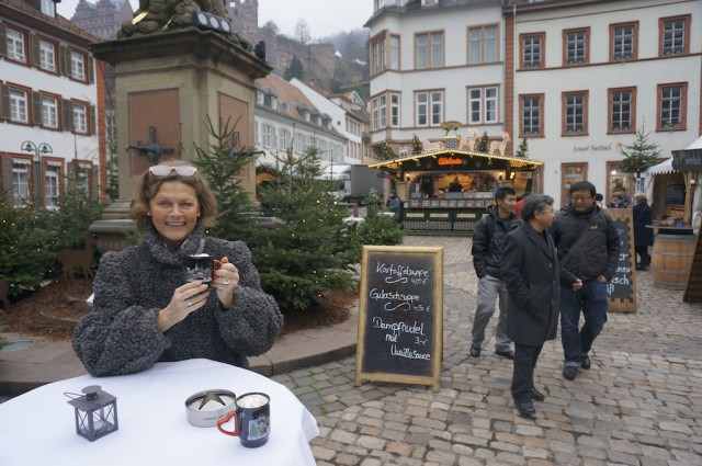 Warming up with a cup of hot chocolate at Heidelberg's Christmas Market. © 2013 Ralph Grizzle