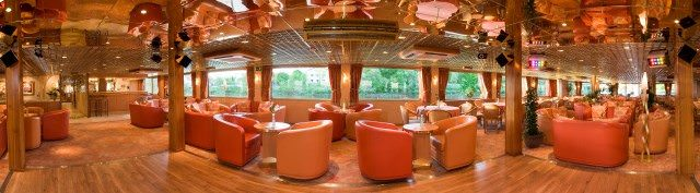 The attractive Lounge aboard L'Europe features comfortable seating and views of the passing scenery. Photo courtesy of CroisiEurope.