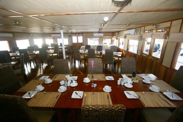 The main dining room aboard the Indochine is an intimate space. Photo courtesy of CroisiEurope.
