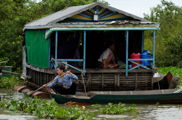 A native Cambodian woman outside her floating house. Photo © 2013 Aaron Saunders
