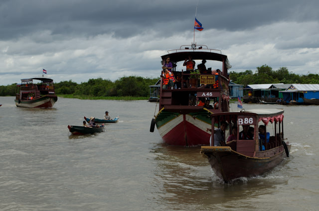 One of the most memorable embarkations ever: a flotilla of ships whisked guests to the waiting AmaLotus on Tonle Sap Lake. Photo © 2013 Aaron Saunders