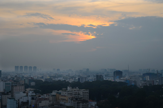 Sunset over Ho Chi Minh City, as viewed from the 23rd floor of the Sheraton Saigon. Photo © 2013 Aaron Saunders