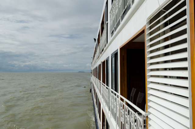 Setting sail across Tonle Sap Lake as our Mekong adventure begins! Photo © 2013 Aaron Saunders