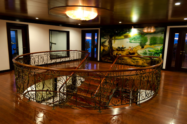 Throughout the ship, an attractive and inviting design is present. This is the Sun Deck landing of the main Atrium staircase. Photo © 2013 Aaron Saunders