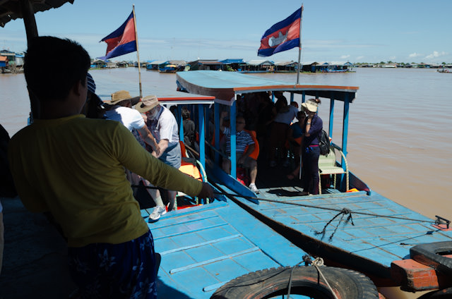 Passengers from the AmaLotus prepare to disembark our local skiffs. Photo © 2013 Aaron Saunders