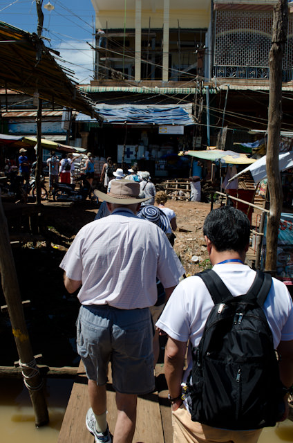 Our walking tour through Kampong Chhnang took us through the town's busy marketplace. Photo © 2013 Aaron Saunders