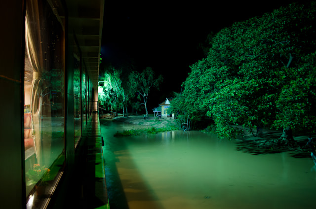 Our night anchorage at Kampong Tralach, Cambodia. Kids were still out splashing and playing by the ship, even at 10pm. Photo © 2013 Aaron Saunders