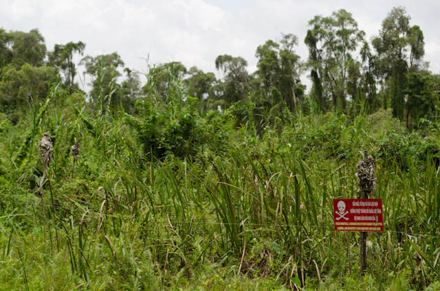 The sign on the right warns of the dangers of landmines beyond this point. Photo © 2013 Aaron Saunders