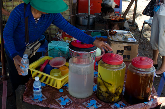 Brewing traditional Cambodian spirits. Photo © 2013 Aaron Saunders