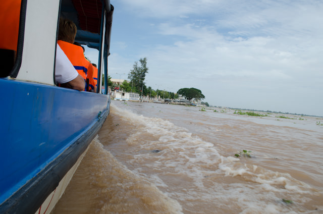 Exploring the Mekong by motorized boat, en-route to a walking tour of a small local village. Photo © 2013 Aaron Saunders