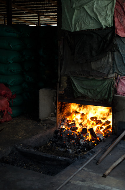 The heat coming from this local metal forge furnace was astonishing in an already-sweltering Tan Chau. Photo © 2013 Aaron Saunders