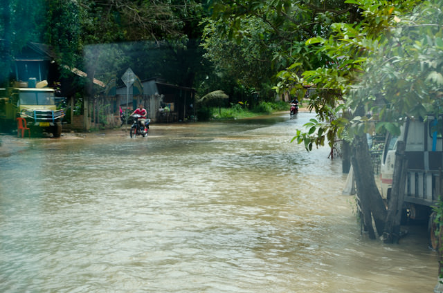 After leaving Siem Reap, we encountered roads that had been washed out by heavy rains in recent days. Photo © 2013 Aaron Saunders