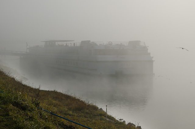 The stern of CroisiEurope's Monet emerges from the fog in Breisach, Germany. Photo © 2013 Aaron Saunders