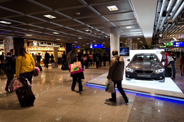 We Must Be In Frankfurt: passers-by admire the squeaky-clean new BMW in Frankfurt's Terminal A. Photo © 2013 Aaron Saunders