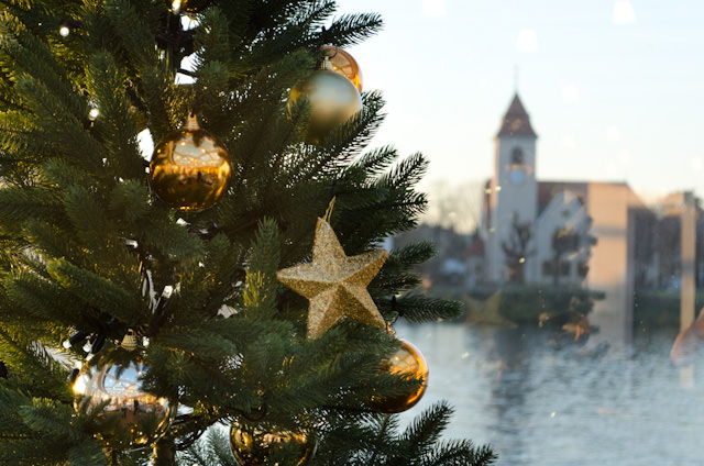 One of the many Christmas trees onboard Viking Rivers' Viking Baldur, with Basel, Switzerland in the background. Photo © 2013 Aaron Saunders