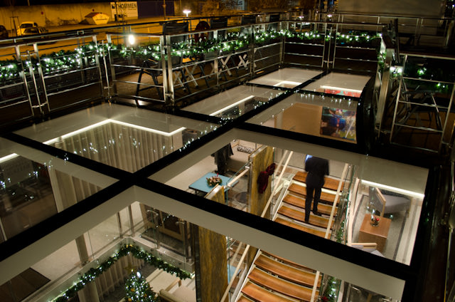 Looking down into the warm, two-story atrium aboard Viking Baldur from the Sun Deck above. Photo © 2013 Aaron Saunders