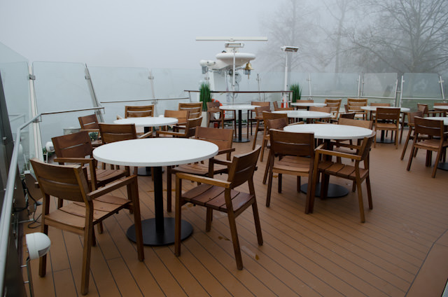 Outdoor seating may not be used much on this voyage, but it is still available. Photo © 2013 Aaron Saunders