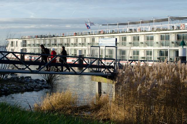 Guests disembark Viking Baldur for an afternoon of touring ashore in Kinderdijk, Netherlands. Photo © 2013 Aaron Saunders