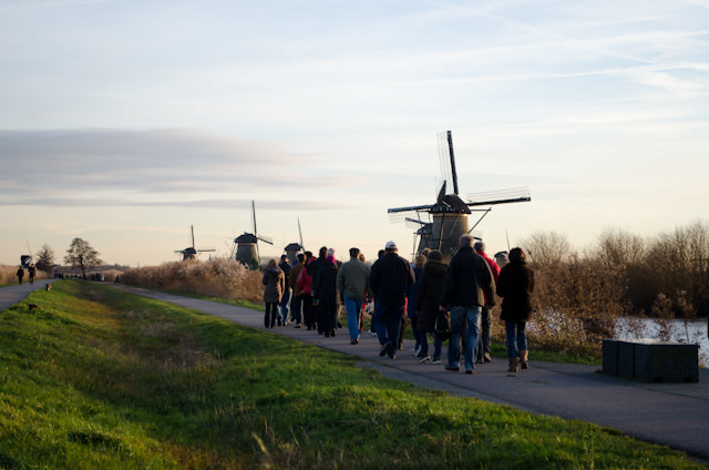 Guests from Viking Baldur stroll towards the windmills of Kinderdijk on their guided tours in the late afternoon. Photo © 2013 Aaron Saunders