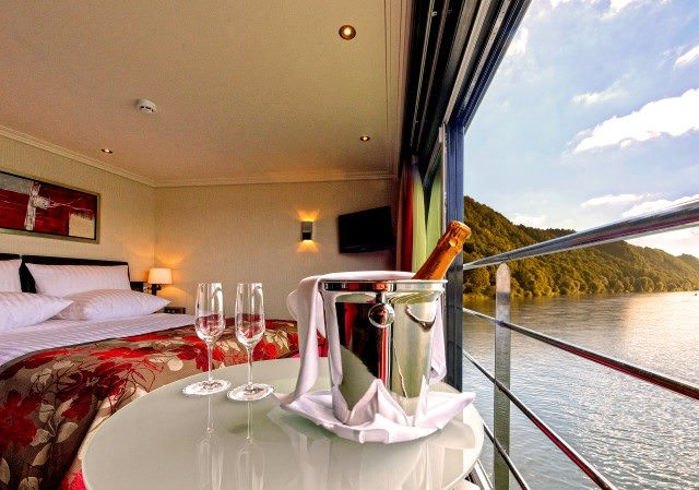 Avalon's Suite Ships feature glass windows that open to create a seven-foot wide open expanse within each suite. Photo courtesy of Avalon Waterways