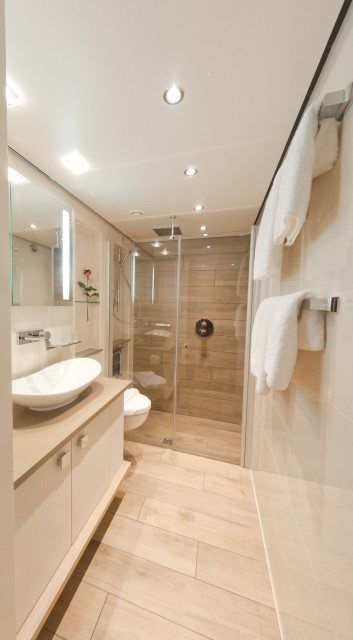 The crisp, clean bathroom in one of Tauck's new Loft Staterooms aboard the ms Inspire. Photo courtesy of Tauck.