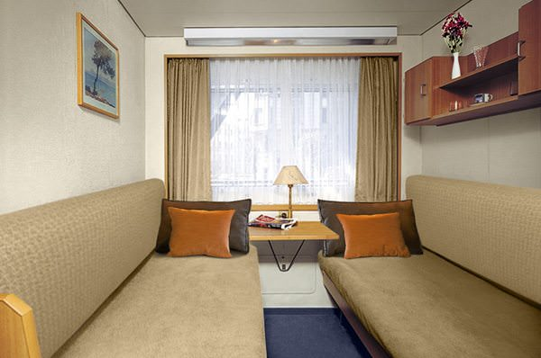 Staterooms featuring fold-out berths weren't uncommon on older river cruise vessels. Pictured here is a pre-refit photograph of one of Viking Peterhof's staterooms; they have since been substantially upgraded. Photo courtesy of Viking River Cruises