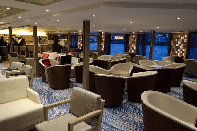The main lounge aboard Viking Torgil and Viking Hemming is attractively patterned after Viking's Longship river cruise vessels - but note the richer colours present here. Photo © 2014 Aaron Saunders