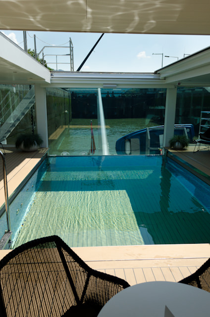The gorgeous swimming pool aboard Emerald Star. Note the opened, retractable roof. Photo © 2014 Aaron Saunders