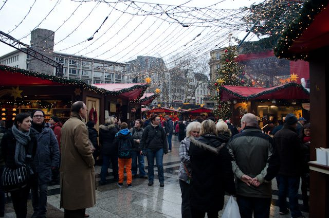 Visitors browse through one of many Christmas Markets in Cologne, Germany. Photo © 2013 Aaron Saunders