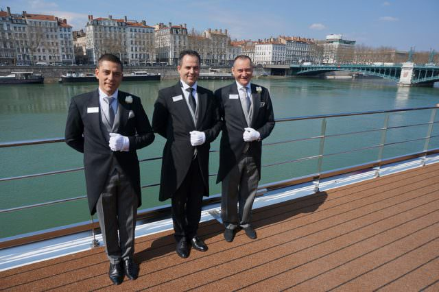 Uniworld's butlers on S.S. Catherine in Lyon, France. © 2014 Ralph Grizzle