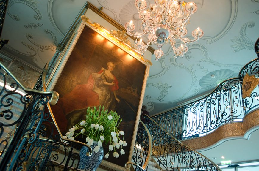 The ornate lobby welcomes guests aboard Uniworld's S.S. Maria Theresa. Photo © 2015 Aaron Saunders