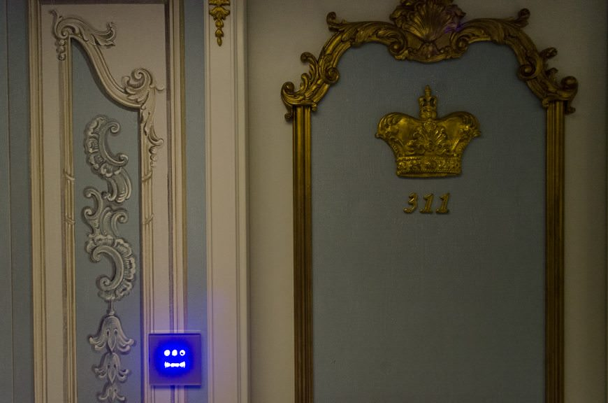Old and New Collide: note the classically-styled stateroom doors and the modern, electronic RFID keycard readers. Photo © 2015 Aaron Saunders