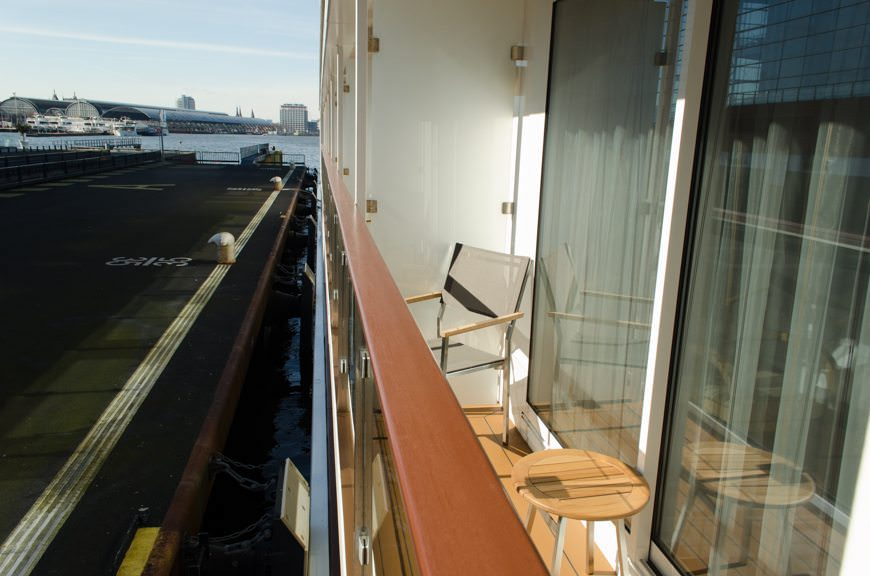 Category A Veranda Staterooms feature full step-out balconies with two chairs and a small table. Photo © 2015 Aaron Saunders