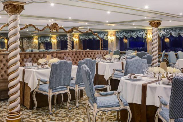 S.S. Maria Theresa's opulent Dining Room. Photo courtesy of Uniworld Boutique River Cruise Collection.