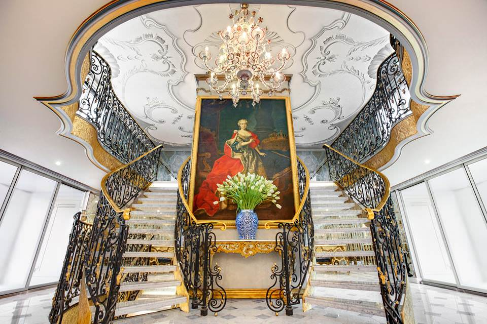The striking atrium lobby aboard Uniworld's new S.S. Maria Theresa welcomes guests into a world of European opulence. Photo courtesy of Uniworld Boutique River Cruise Collection.