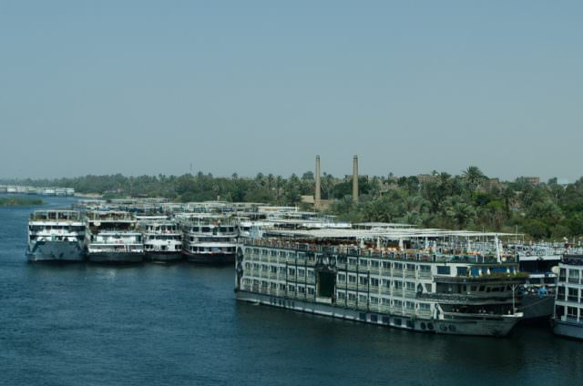 Despite the return of tourists, much of the Nile fleet is still laid-up along her banks. Photo © 2015 Aaron Saunders