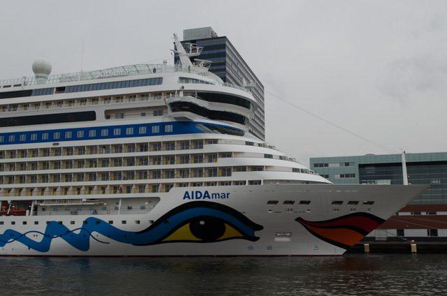 AIDA Cruises' AIDAmar docked at the Passenger Terminal Amsterdam - just half a block from the river cruise ship docks. Photo © 2015 Aaron Saunders